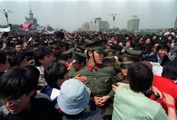 "May 4: Over 100,000 ""pro-democracy"" students surround a group of unarmed policemen, demanding for ""democracy"" and ""freedom""."