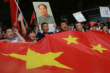 Chinese demonstrators march on the Japanese embassy in Beijing, declaring the Diaoyu Islands belonging to China.