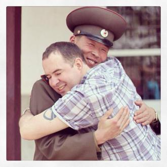 Fellow traveler and Citizen Diplomat to North Korea, Michael Bassett, hugging a 1st Lieutenant (상위) of the KPA.  For more photos by Michael Bassett, click here.